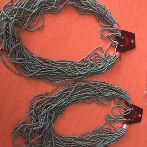 Short red and silver necklace with earrings